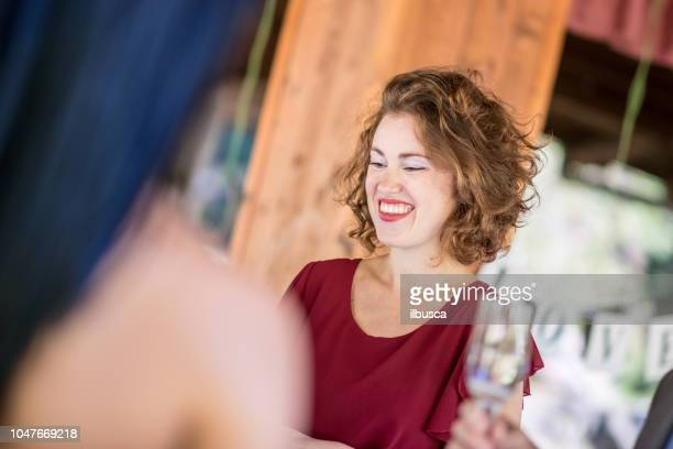 Same sex gay wedding ceremony and party: Guests drinking and talking with spouse