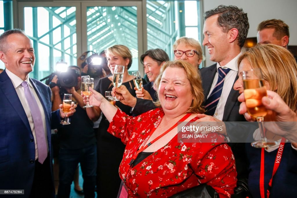 Same Sex Marriage Ambassador Magda Szubanski celebrates with Labor opposition leader Bill Shorten (L) and members of the Labor Party after the Australian Parliament passed the same-sex marriage bill in Canberra on December 7, 2017. Gay couples will be able to legally marry in Australia after a same-sex marriage bill sailed through parliament on December 7, ending decades of political wrangling. /