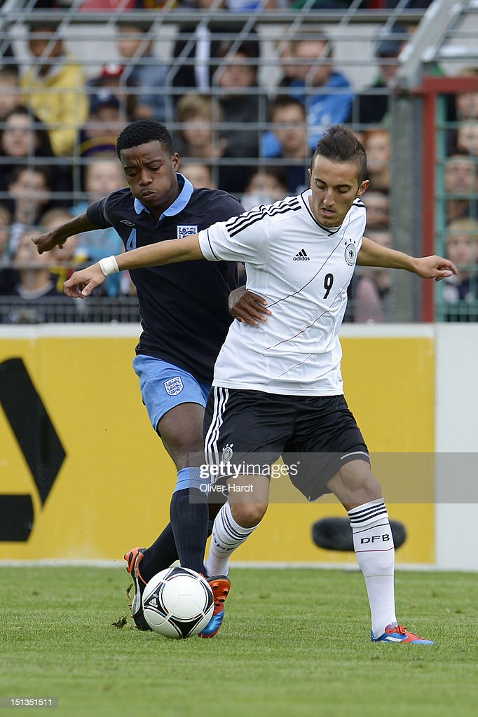 Samed Yesil (R) of Germany and Nathaniel Chalobah (L) of England battle for the ball during the Under 19 international friendly match between Germany and England at Stadion an der Lohmuehle on September 6, 2012 in Luebeck, Germany.