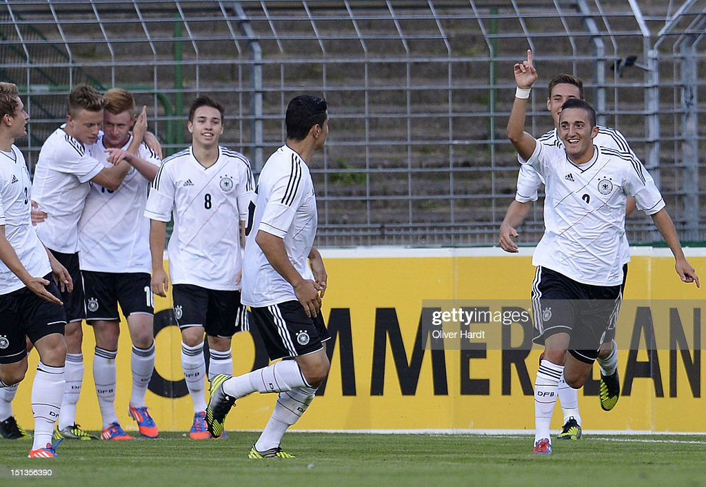 Samed Yesil (R) of Germany celebrates after scoring their second goal during the Under 19 international friendly match between Germany and England at Stadion an der Lohmuehle on September 6, 2012 in Luebeck, Germany.