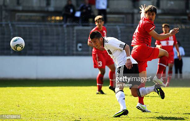 Samed Yesil of Germany heads his teams first goal during the UEFA U17 European Championship Elite Round match between Germany and Turkey at...