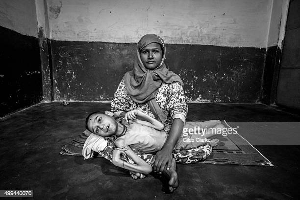 Sameer Hasan 16 years old with his mother Wahida Bee at home Sameer was born to parents contaminated by a carcinogenic and mutagenic water supply...