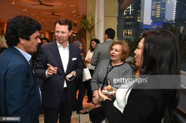 Sameh Abdul Hameed Olivier Thomas Laila Hafez and Reem Mahmoud attend cocktail reception at Cafe Milano Four Seasons Hotel Abu Dhabi at Al Maryah...