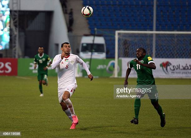 Sameh Maraaba of Palestinian national team and Abdulmalek Abdullah Al Khaibri of Saudi Arabia contest the ball during the AFC qualifying Group A...