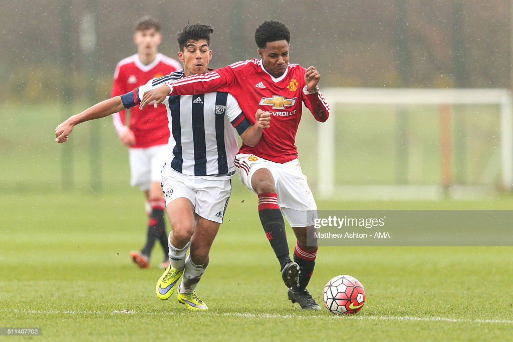 Sameron Dool of West Bromwich Albion U18 and DJ Buffonge of Manchester United U18 during the U18 Premier League match between Manchester United and West Bromwich Albion at Aon Training Complex on February 20, 2016 in Manchester, England.