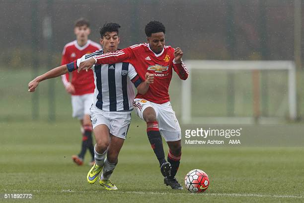 Sameron Dool of West Bromwich Albion U18 and DJ Buffonge of Manchester United U18 during the U18 Premier League match between Manchester United and...