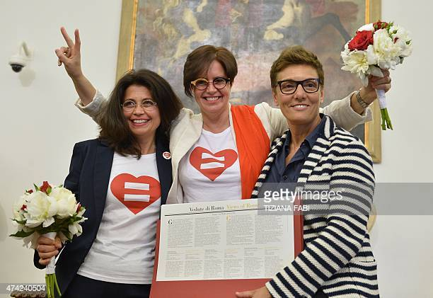 Samesex couple Daniela Bellisario and Barbara Vecchieti pose with gay rights activist Imma Battaglia after they registered their civil union at...