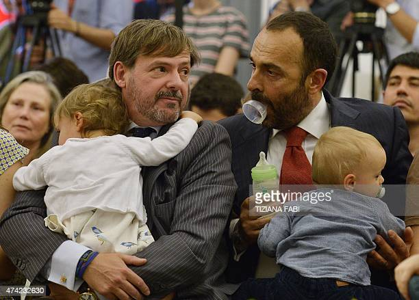 Samesex couple Dario De Gregorio and Andrea Rubera wait with their children to register their civil union at Rome's city hall on May 21 2015 in Rome...