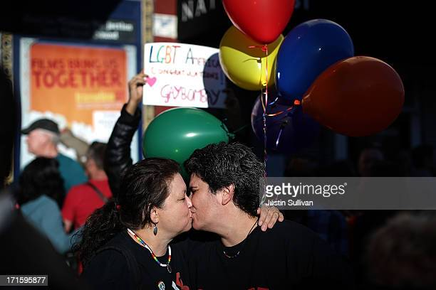 Samesex couple Frances Winn and Carrie McLaughlin celebrate during a block party on Castro Street on June 26 2013 in San Francisco California The...