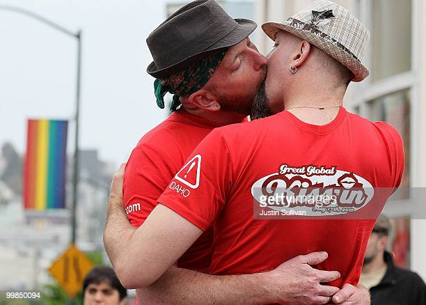 Samesex couple J Inness and Drew Staffen kiss in front of the Castro Theatre during a KissIn to recognize the International Day Against Homophobia...