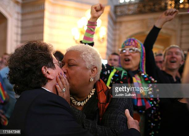 Samesex couple Jewelle Gomez and Diane Sabin react upon hearing the US Supreme Court's rulings on gay marriage in City Hall June 26 2013 in San...