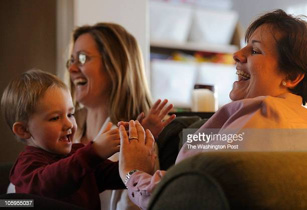 Samesex couple Karen Bell with son Andrew Bell Chryssa Zizos share a laugh at their home in Arlington Virginia on Thursday January 7 2010 With the...
