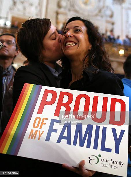 Samesex couple Lori Bilella and Renara Moreira celebrate the results from the US Supreme Court's rulings on gay marriage in City Hall June 26 2013 in...