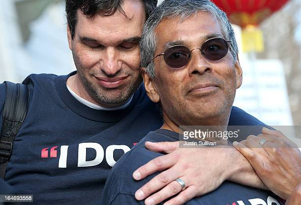 Samesex couple Mark Guzman Scott Coatsworth embrace during a rally in support of marriage equality on March 26 2013 in San Francisco California...