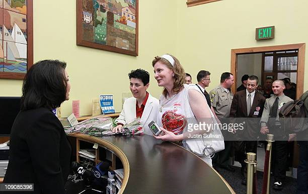 Samesex couple Molly McKay and Davina Kotulski request a marriage license from San Francisco County Clerk director Karen Hong Yee on February 14 2011...