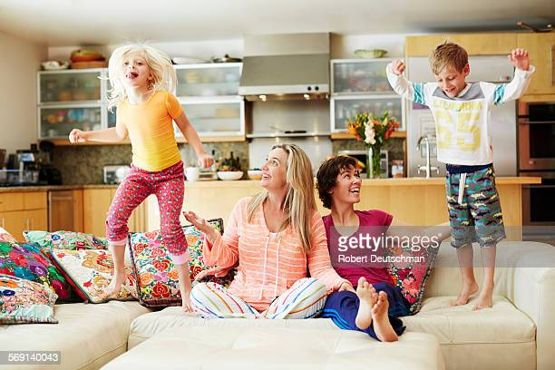 same-sex couple playing with their kids. - mom son sex photo stock pictures, royalty-free photos & images