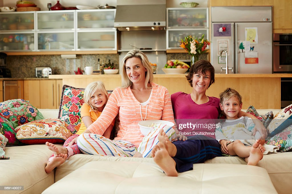 Samesex Couple Sitting In House With Kids Photo - Getty Images-1194
