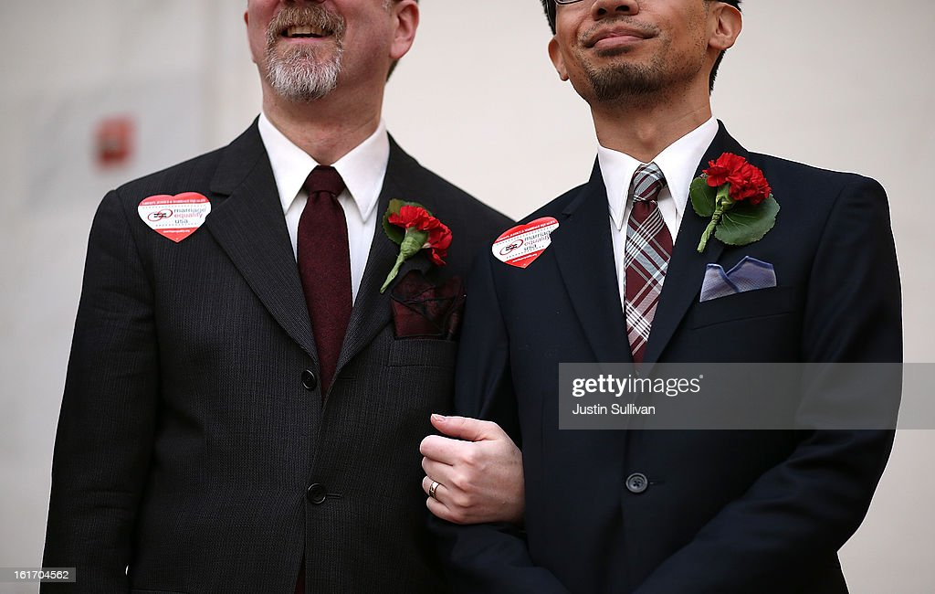Same-sex couple Thom Watson (L) and Jeff Tabaco look on before staging a sit-in protest after same-sex couples were denied marriage licenses from the San Francisco county clerk on February 14, 2013 in San Francisco, California. Close to a dozen same-sex couples who were denied marriage licenses were arrested after they staged a sit-in demonstration inside the office of San Francisco's county clerk.