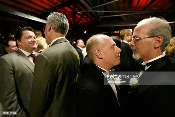 Samesex couples exchange marriage vows during a symbolic mass gay wedding celebrated by more than 100 samesex couples on June 1 2004 in West...