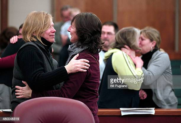 Samesex couples get married in a group ceremony at the Oakland County Courthouse on March 22 2014 in Pontiac Michigan A Federal judge overturned...