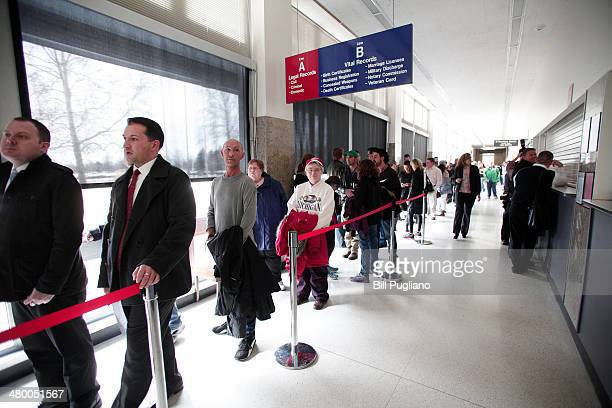 Samesex couples line up to get marriage licenses at the Oakland County Courthouse on March 22 2014 in Pontiac Michigan A Federal judge overturned...