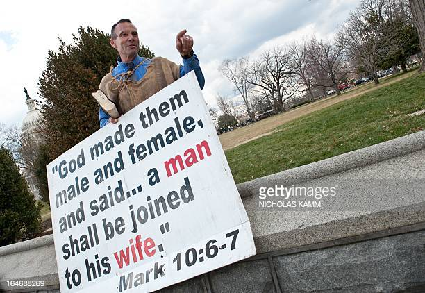 Samesex marriage opponent Alan Hoyle of the Wake Up Call Ministry argues with supporters of samesex marriage across from the US Supreme Court in...