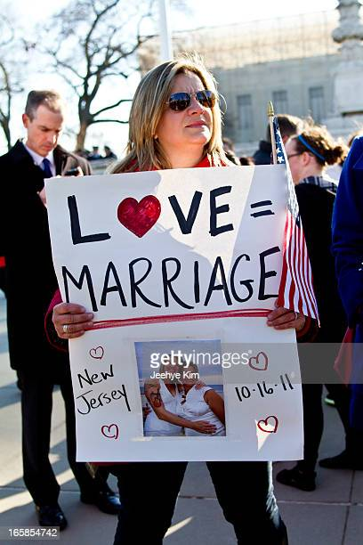 Same-sex marriage supporter holds a sign during the Prop 8 and DOMA rally at the Supreme Court of the United States; 2013