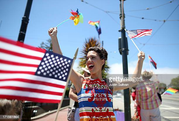 Samesex marriage supporter Lindsey Freitas waves an American flag as she celebrates on the corner of Market and Castro on June 26 2013 in San...