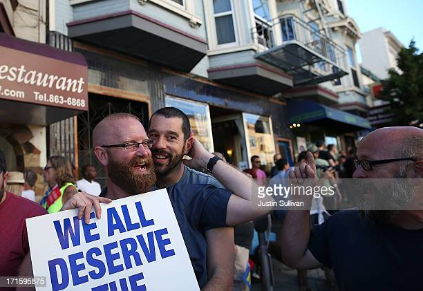 Samesex marriage supporters celebrate during a block party on Castro Street on June 26 2013 in San Francisco California The Supreme Court of the...