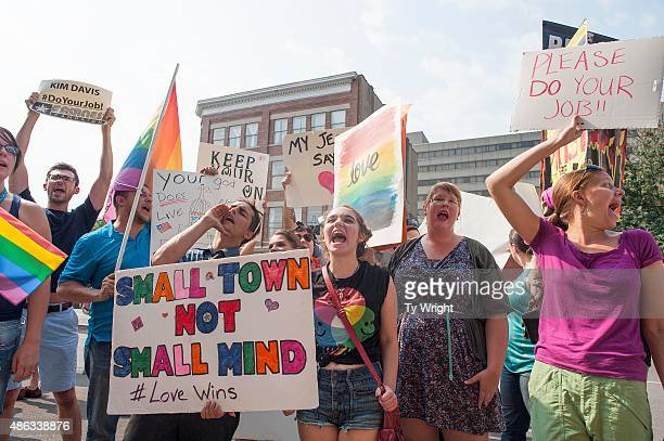 Samesex marriage supporters chant during a protest in front of the federal courthouse September 3 2015 in Ashland Kentucky Kim Davis the Rowan County...