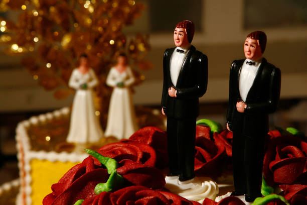 Same-sex wedding cake topper figurines are seen at Cake and Art cake decorators June 10, 2008 in West Hollywood, California. Business is increasing...