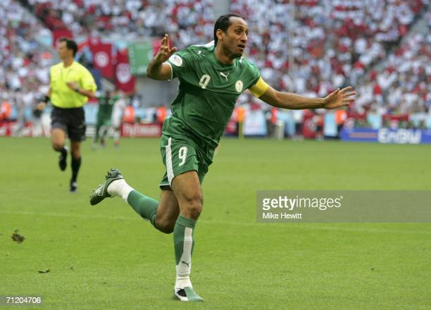 Sami Al Jaber of Saudi Arabia celebrates after scoring his team's second goal during the FIFA World Cup Germany 2006 Group H match between Tunisia...