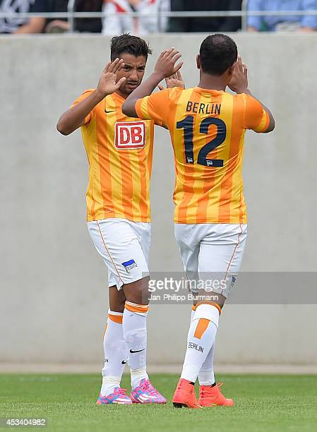 Sami Allagui and Ronny celebrate after scoring the 1:0 during the test match between SV Rödinghausen and Hertha BSC on july 15, 2014 in Rödinghausen,...