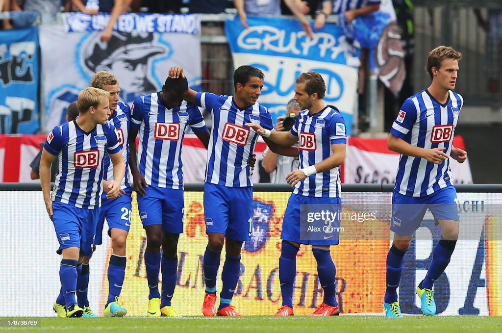 Sami Allagui (3R) of Berlin celebrates his team's first goal with team mates during the Bundesliga match between 1. FC Nuernberg and Hertha BSC Berlin at Grundig Stadium on August 18, 2013 in Nuremberg, Germany.