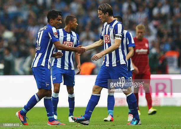 Sami Allagui of Berlin celebrates with his team mate Peter Niemeyer after scoring his team's first goal during the Second Bundesliga match between...