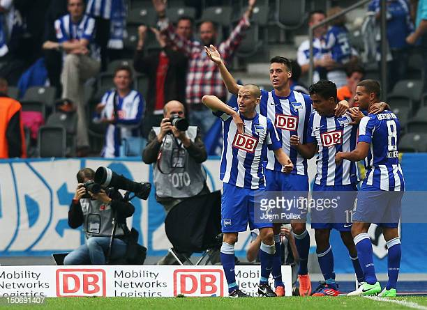 Sami Allagui of Berlin celebrates with his team mates after scoring his team's first goal during the Second Bundesliga match between Hertha BSC...