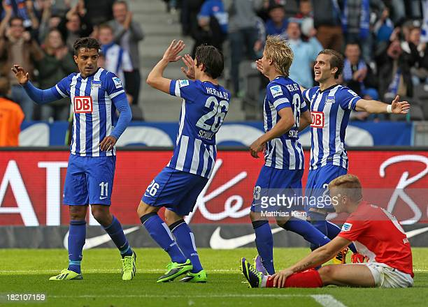 Sami Allagui of Berlin jubilates with team mates after scoring the third goal during the Bundesliga match between Hertha BSC and 1FSV Mainz 05 at...