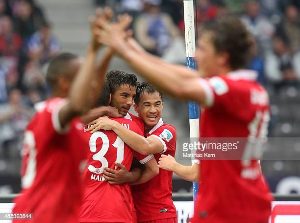 Sami Allagui of Mainz jubilates with team mates after scoring the second goal during the Bundesliga match between Hertha BSC and 1FSV Mainz 05 at...
