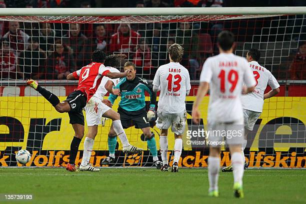 Sami Allagui of Mainz scores the first goal against Michael Rensing of Koeln during the Bundesliga match between 1 FC Koeln and FSV Mainz 05 at...