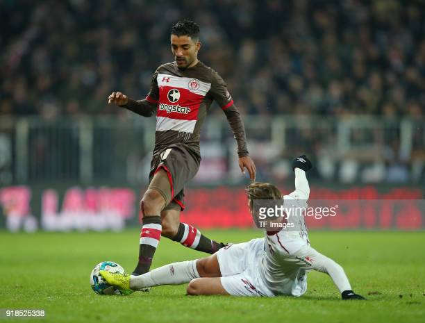 Sami Allagui of St Pauli and Enrico Valentini of Nuernberg battle for the ball during the Second Bundesliga match between FC St Pauli and 1 FC...