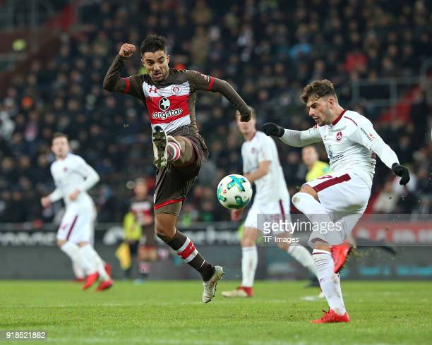 Sami Allagui of St Pauli and Tim Leibold of Nuernberg battle for the ball during the Second Bundesliga match between FC St Pauli and 1 FC Nuernberg...