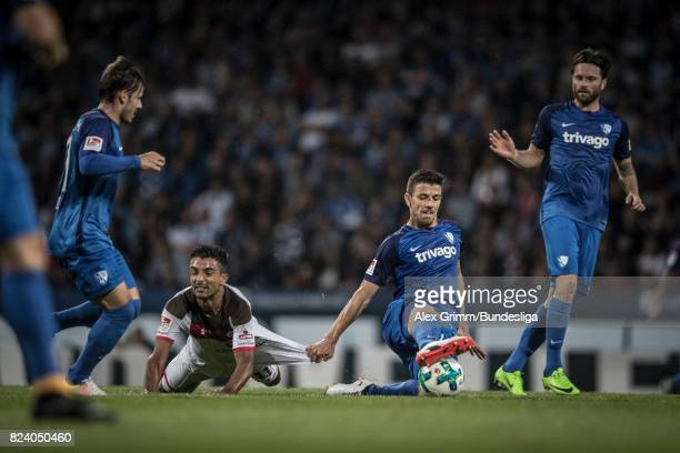 Sami Allagui of St Pauli is tackled by Stefano Celozzi Anthony Losilla and Tim Hoogland of Bochum during the Second Bundesliga match between VfL...