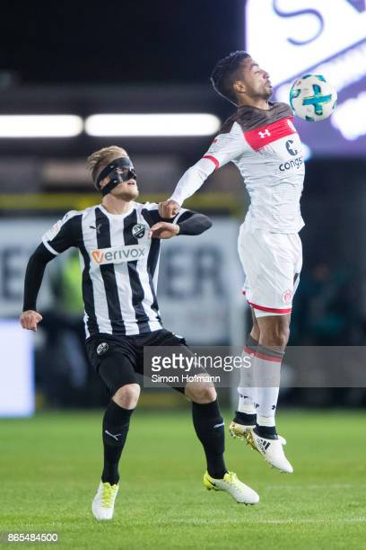 Sami Allagui of St Pauli jumps for a header with Marcel Seegert of Sandhausen during the Second Bundesliga match between SV Sandhausen and FC St...