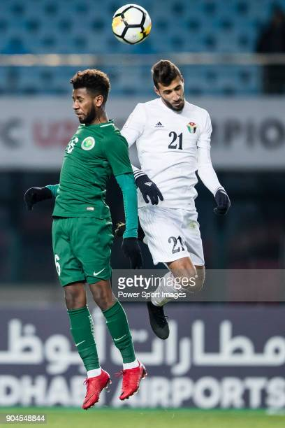 Sami AlNajei of Saudi Arabia fights for the ball with Ward Al Barri of Jordan during the AFC U23 Championship China 2018 Group C match between Jordan...