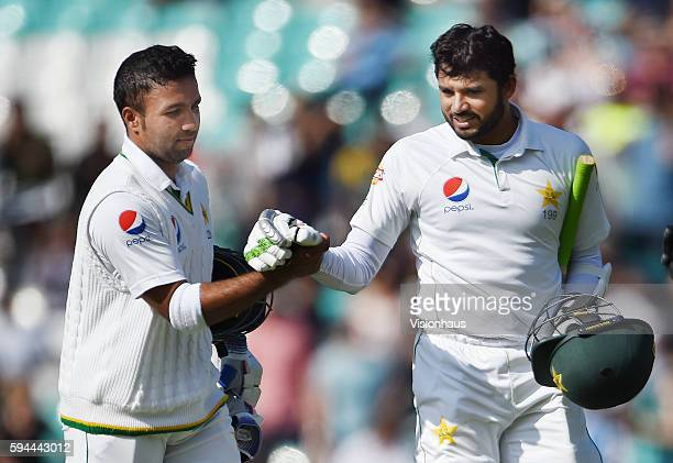 Sami Aslam and Azhar Ali walk from the oitch after winning the match for Pakistan during day four of the fourth Investec test match between England...