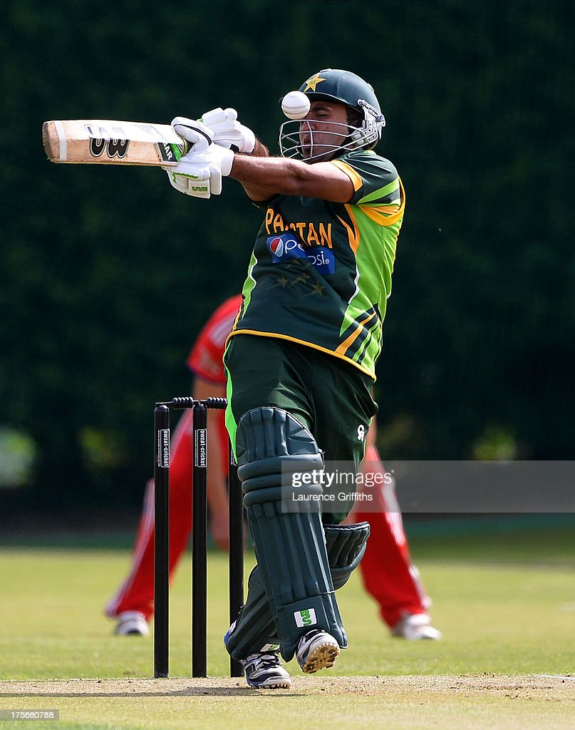 Sami Aslam of Pakistan is hit on the head by a bouncer during the Under 19 International Tri-series match between England and Pakistan at Sleaford Cricket Clun on August 6, 2013 in Sleaford, England.