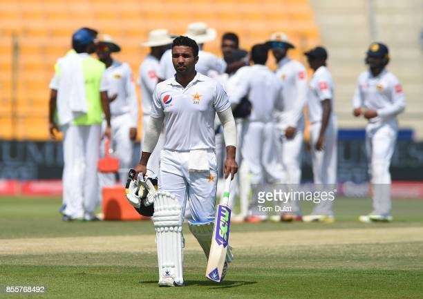 Sami Aslam of Pakistan leaves the field after being dismissed by Dilruwan Perera of Sri Lanka during Day Three of the First Test between Pakistan and...