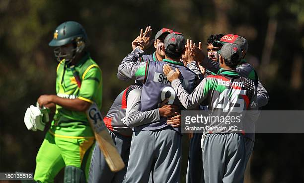 Sami Aslam of Pakistan leaves the field looking dejected as the Afghanistan players celebrate after Aslam was caught out during the ICC U19 Cricket...