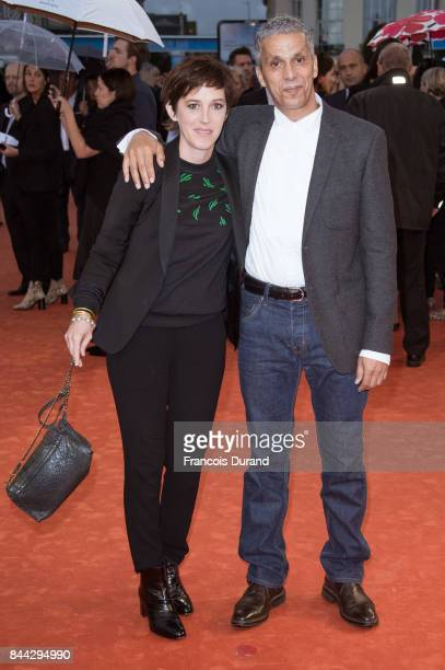 Sami Bouajila and guest arrive at the screening for 'mother' during the 43rd Deauville American Film Festival on September 8 2017 in Deauville France