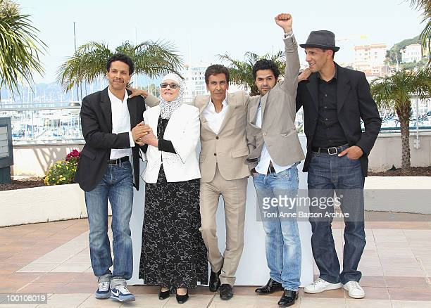 Sami Bouajila Chafia Boudraa Director Rachid Bouchareb Jamel Debbouze and Roschdy Zem attend the 'Outside the Law' Photo Call held at the Palais des...